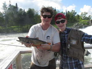 Max caught this truly once in a lifetime trophy wild Maine Brook Trout. I lost my hat and got a little dirty trying to get this beast into the net but it was well worth it.